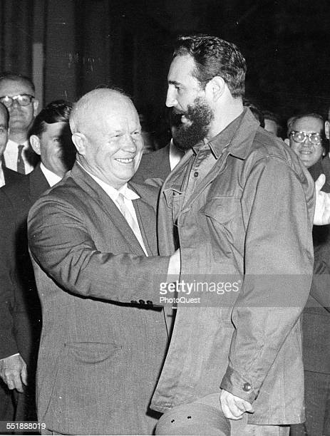Russian politician and Premier Nikita Krushchev moves to hug Cuban Premier Fidel Castro as the latter arrives for dinner at the Soviet legation New...
