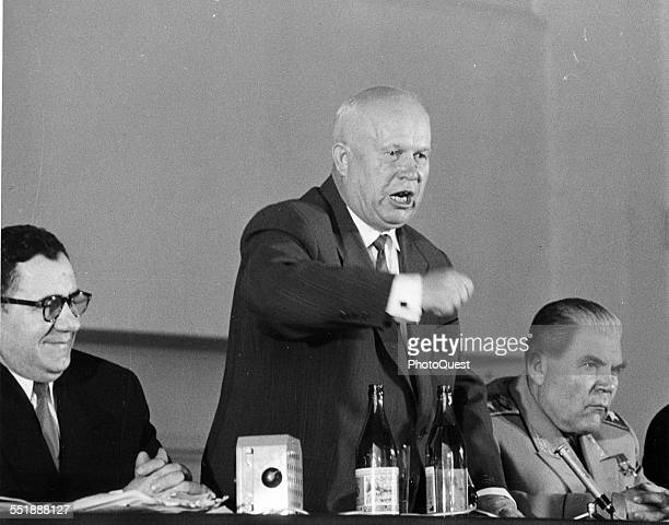 Russian politician and Premier Nikita Krushchev stands and shakes his fist during his farewell press conference Paris France May 18 1960 With him is...