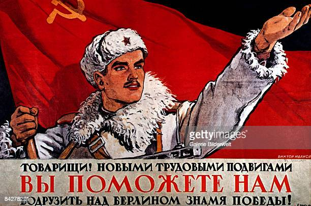 A Russian poster depicting a soldier with a Communist flag above the words 'Comrade Your efforts will help us raise the flag of victory over Berlin'...