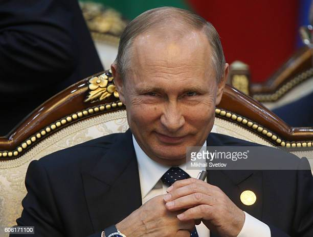 Russian Preisdent Vladimir Putin smiles during the Commonwealth of Independent States Summit plenary session on September 16 2016 in Bishkek...