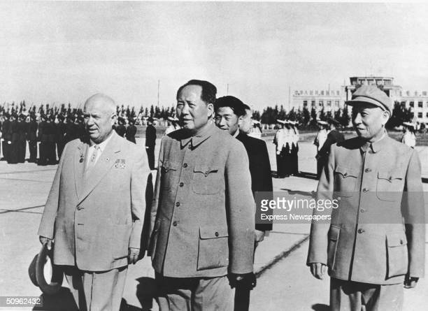 Russian premier Nikita Khrushchev Chinese Communist leaders Mao Zedong and Liu Shaoqi survey the Chinese troops at Peking Airport China October 1959...