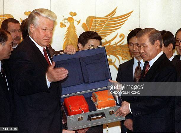 Russian President Boris Yeltsin shown in file picture dated 19 November 1992 in Seoul hands over the 'black box' of the Korean Air jumbo jet downed...
