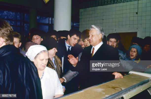 Russian President Boris Yeltsin visiting a dairy shop in Gorki Russia on 12th June 1992 On the left from Yeltsin Boris Nemtsov chief od admnistration...