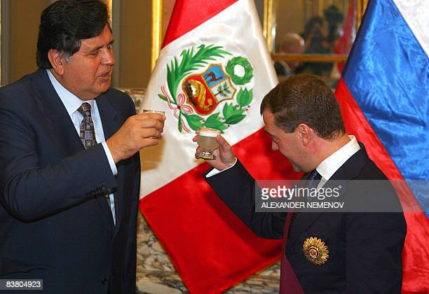 Russian President Dmitry Medvedev and his Peruvian counterpart Alan Garcia toast with a traditional Peruvian 'pisco sour' drink after Medvedev was...