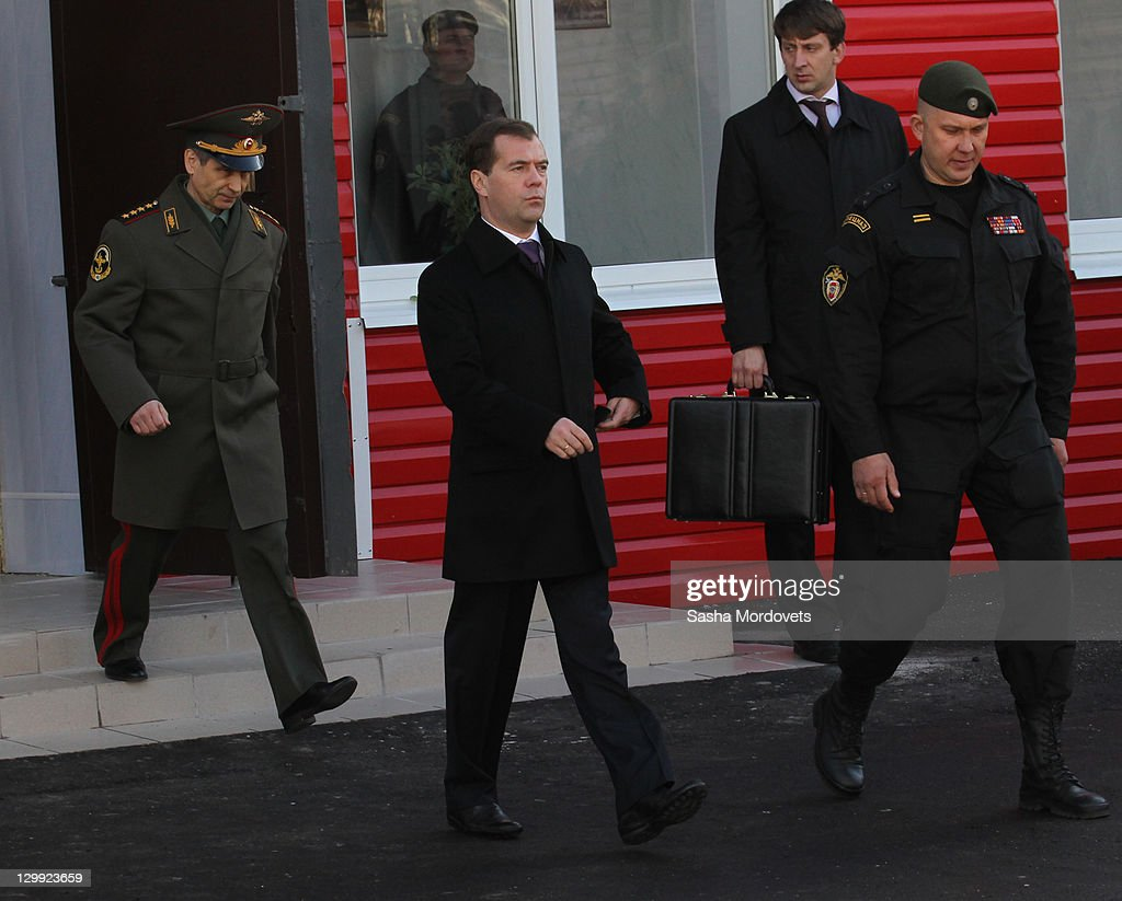 Russian President <a gi-track='captionPersonalityLinkClicked' href=/galleries/search?phrase=Dmitry+Medvedev&family=editorial&specificpeople=554704 ng-click='$event.stopPropagation()'>Dmitry Medvedev</a> (C) and Interior Minister Rashid Nurgaliyev (L) arrive to the trainings at the spetsnaz camp, a special commando unit of Russian Interior Ministry October, 22, 2011 in Tver, Russia. Medvedev launched a large-scale reform of the Russian Interior Ministry in 2009 with staff reductions and tighter penalties for police found guilty of crimes in response to criticism of the country's police force.