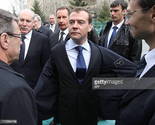 Russian President Dmitry Medvedev and Irkutsk Governor Dmitry Mezentsev inspect a residential apartment block on April 18 2011 in the Siberian city...