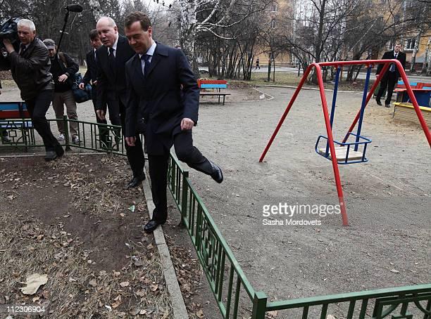Russian President Dmitry Medvedev and Irkutsk Governor Dmitry Mezentsev inspect a residential apartment block April 18 2011 in the Siberian city of...