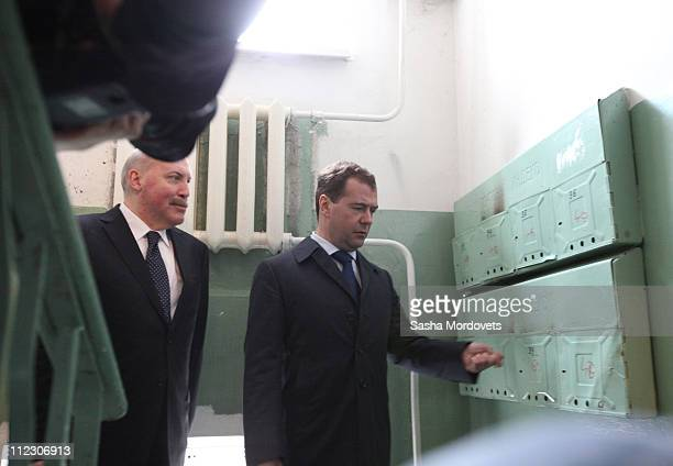 Russian President Dmitry Medvedev and Irkutsk Governor Dmitry Mezentsev inspect post boxes in a residential apartment block April 18 2011 in the...
