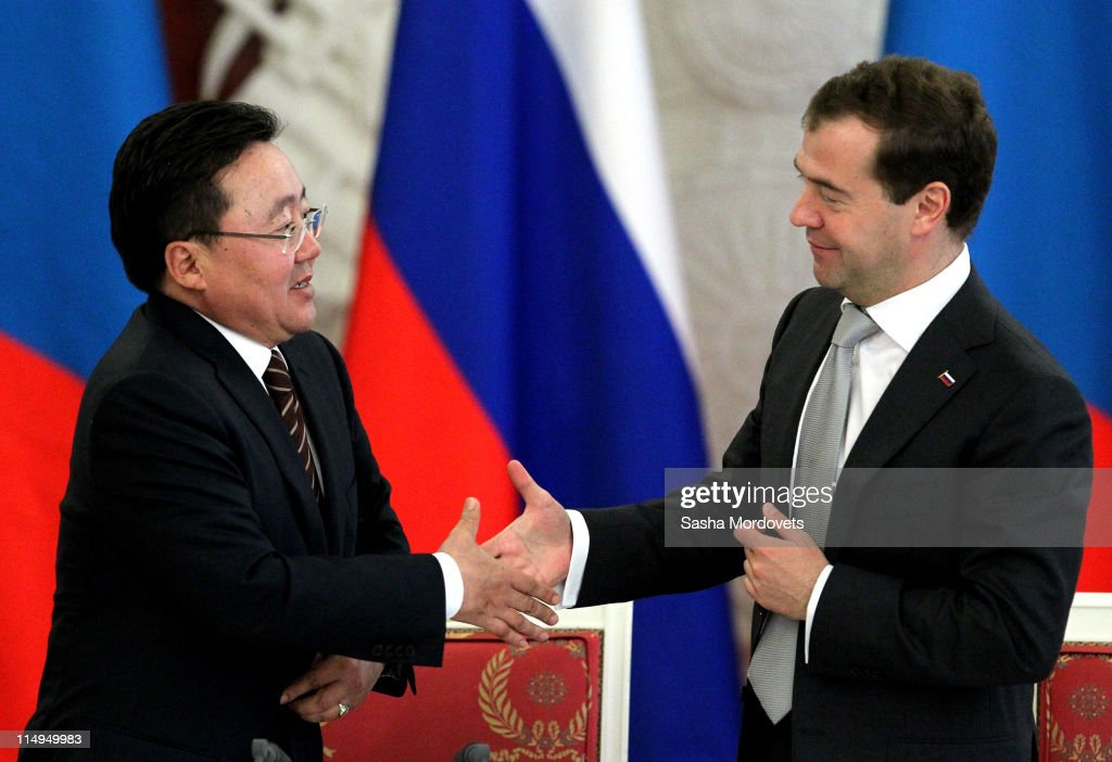 Russian President <a gi-track='captionPersonalityLinkClicked' href=/galleries/search?phrase=Dmitry+Medvedev&family=editorial&specificpeople=554704 ng-click='$event.stopPropagation()'>Dmitry Medvedev</a> (R) and Mongolian President Tsakhia Elbegdorj (L) shake hands during a joint news conference in Moscow's Kremlin on May 31, 2011in Moscow, Russia.