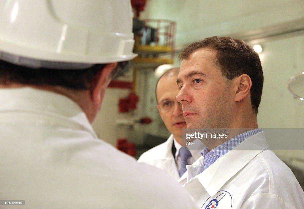 Russian President Dmitry Medvedev (R) and Sergei Kirienko (2nd R), head of Russia's Nuclear Energy State Corporation (Rosatom), listen to explanations as they visit Leningrad nuclear power station, 80 km (50 miles) from St. Petersburg on May 29, 2010.