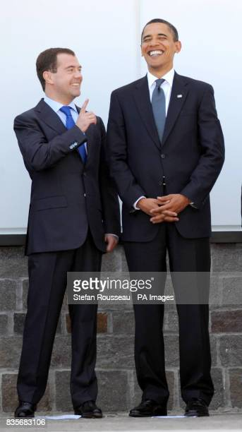 Russian President Dmitry Medvedev and US President Barack Obama during a group photo at the G8 summit in L'Aquila Itlay