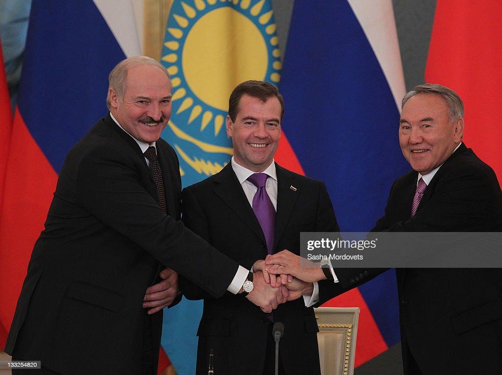 Russian President Dmitry Medvedev Belarus's President Alexander Lukashenko and Kazakh President Nursultan Nazarbayev shake hands during their meeting...