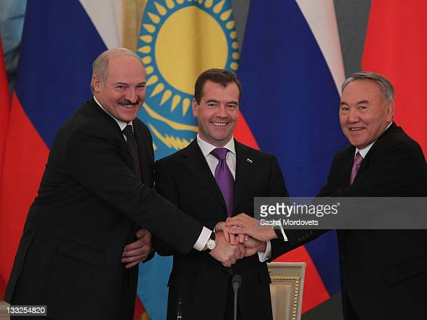Russian President Dmitry Medvedev Belarus's President Alexander Lukashenko and Kazakh President Nursultan Nazarbayev shake hands during their meeting...