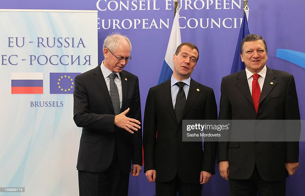 Russian President Dmitry Medvedev (C), European Council President <a gi-track='captionPersonalityLinkClicked' href=/galleries/search?phrase=Herman+Van+Rompuy&family=editorial&specificpeople=4476281 ng-click='$event.stopPropagation()'>Herman Van Rompuy</a> (L) and European Commission President Jose Manuel Barroso (R) pose for a photo during the Russia-EU Summit on December 15, 2011 in Brussels, Belgium. The Russia-EU summit is expected to approve an array of bilateral steps towards mutual visa-free travel and addresses the current difficulties in the EU economy.