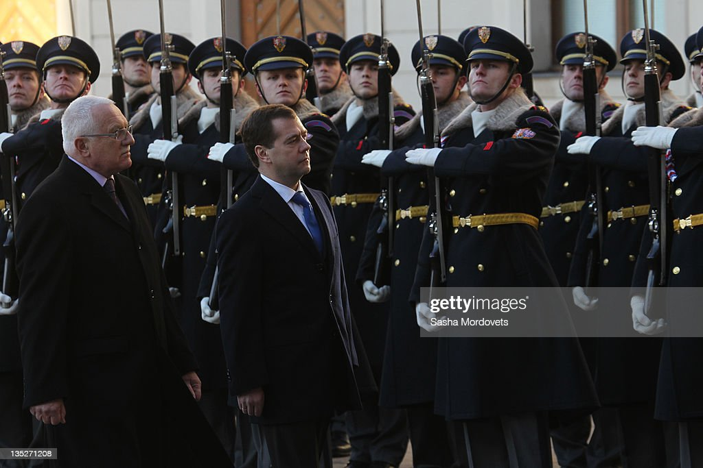 Russian President Dmitry Medvedev followed by Czech President Vaclav Claus arrive during a visit to the city on December 8 2011 in Prague Czech...