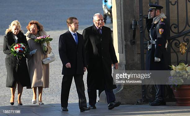 Russian President Dmitry Medvedev his spouse Svetlana Medvedeva followed by Czech President Vaclav Claus and his wife Livia Rosamunda Clausova during...