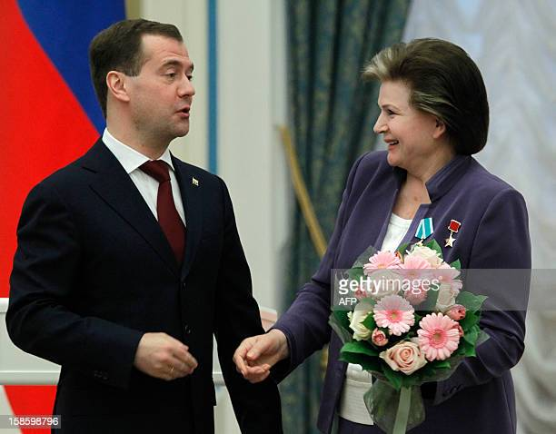 Russian President Dmitry Medvedev jokes with Soviet former cosmonaut and first woman in space Valentina Tereshkova after awarding her with the medal...