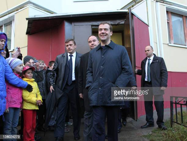 Russian President Dmitry Medvedev leaves a house after meeting residents in NaryanMar a capital of Nenets Autonomous region on October 2011 in Russia...