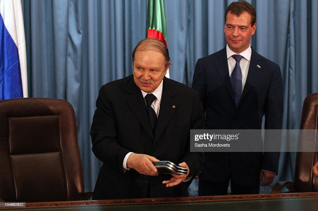 Russian President Dmitry Medvedev (R) meets Algerian President <a gi-track='captionPersonalityLinkClicked' href=/galleries/search?phrase=Abdelaziz+Bouteflika&family=editorial&specificpeople=176720 ng-click='$event.stopPropagation()'>Abdelaziz Bouteflika</a> October 6, 2010 in Algiers, Algeria. Medvedev is on a one-day state visit to Algeria to discuss energy and telecoms deals.