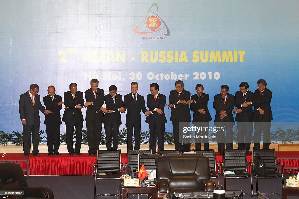 Russian President Dmitry Medvedev (C) shakes hands with Philippine President Benigno Aquino (L), Singapore Prime Minister <a gi-track='captionPersonalityLinkClicked' href=/galleries/search?phrase=Lee+Hsien+Loong&family=editorial&specificpeople=3911578 ng-click='$event.stopPropagation()'>Lee Hsien Loong</a> (2nd L), Thailand Prime Minister <a gi-track='captionPersonalityLinkClicked' href=/galleries/search?phrase=Abhisit+Vejjajiva&family=editorial&specificpeople=645779 ng-click='$event.stopPropagation()'>Abhisit Vejjajiva</a> (2nd R) and Vietnamese Prime Minister <a gi-track='captionPersonalityLinkClicked' href=/galleries/search?phrase=Nguyen+Tan+Dung&family=editorial&specificpeople=544511 ng-click='$event.stopPropagation()'>Nguyen Tan Dung</a> (3rd R) along with other heads of state during the the ASEAN-Russia Summit on October 30, 2010 in Hanoi, Vietnam. The summit is taking place on the sidelines of the 17th ASEAN Summit and Medevev has stated his recognition of the importance of continuing to develop relations with ASEAN nations from both a business and security perspective.