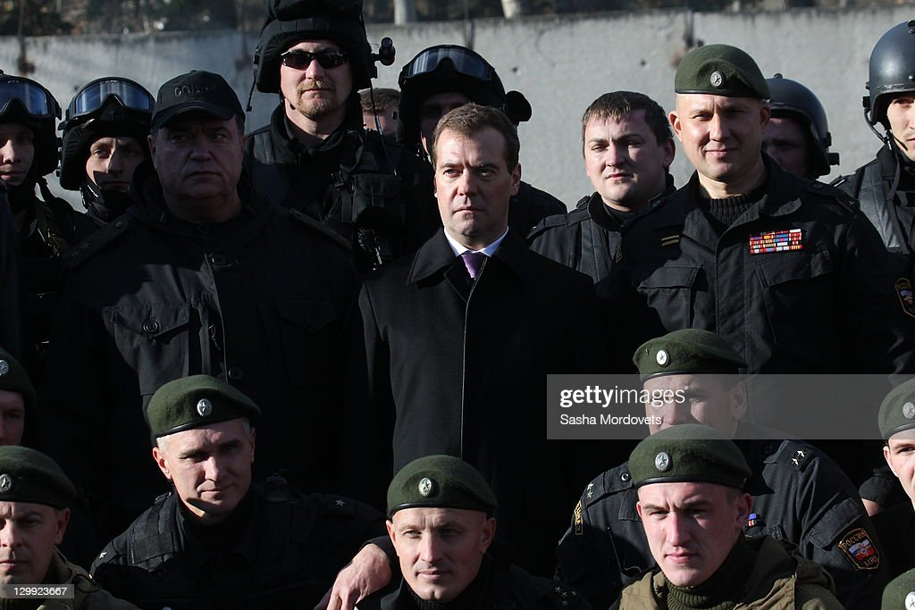 Russian President Dmitry Medvedev surrounded by spetsnaz officers poses for a photo at the spetsnaz camp, a special commando unit of Russian Interior Ministry October, 22, 2011 in Tver, Russia. Medvedev launched a large-scale reform of the Russian Interior Ministry in 2009 with staff reductions and tighter penalties for police found guilty of crimes in response to criticism of the country's police force.