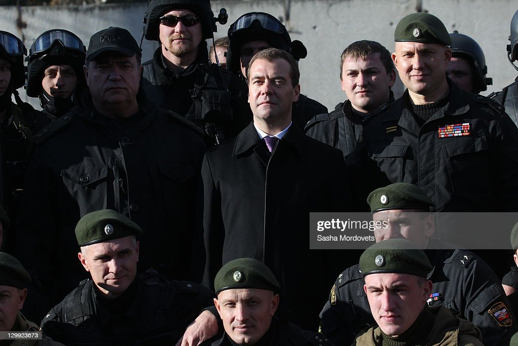 Russian President <a gi-track='captionPersonalityLinkClicked' href=/galleries/search?phrase=Dmitry+Medvedev&family=editorial&specificpeople=554704 ng-click='$event.stopPropagation()'>Dmitry Medvedev</a> surrounded by spetsnaz officers poses for a photo at the spetsnaz camp, a special commando unit of Russian Interior Ministry October, 22, 2011 in Tver, Russia. Medvedev launched a large-scale reform of the Russian Interior Ministry in 2009 with staff reductions and tighter penalties for police found guilty of crimes in response to criticism of the country's police force.