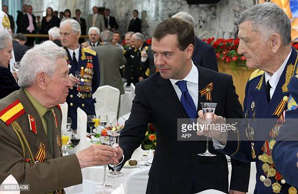 Russian President Dmitry Medvedev toasts vodka with WWII veterans to celebrate Victory Day at the Kremlin in Moscow on May 9 2009 in commemoration of...