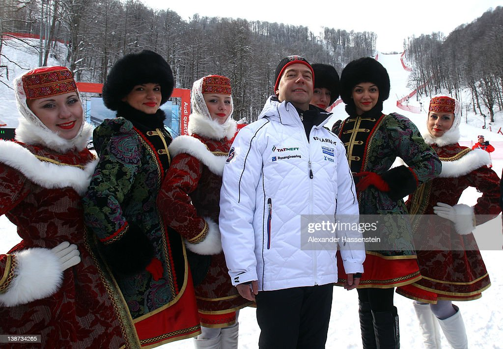 Russian president <a gi-track='captionPersonalityLinkClicked' href=/galleries/search?phrase=Dmitry+Medvedev&family=editorial&specificpeople=554704 ng-click='$event.stopPropagation()'>Dmitry Medvedev</a> with flower bearers after the Men's Downhill at the Audi FIS World Cup on February 11, at Rosa Khutor Mountain Resort in Sochi, Russia.