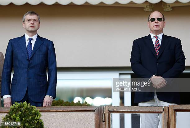 Russian president of AS Monaco football club Dmitri Rybolovlev stands beside Prince's Albert II of Monaco before the start of a French L2 football...