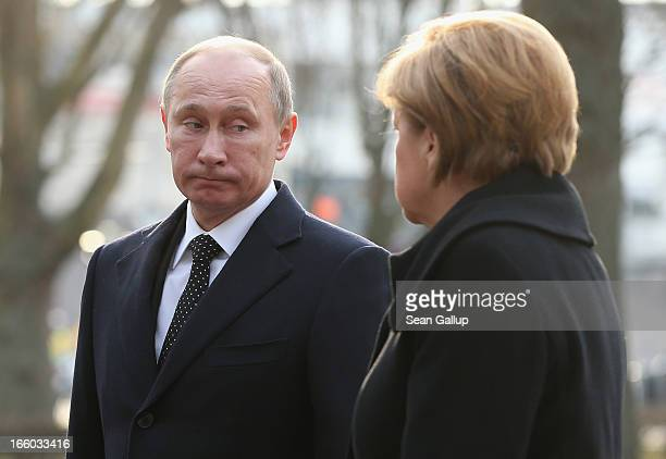 Russian President Valdimir Putin and German Chancellor Angela Merkel arrive to pay tribute to 526 prisoners of war including 154 Soviet soldiers...