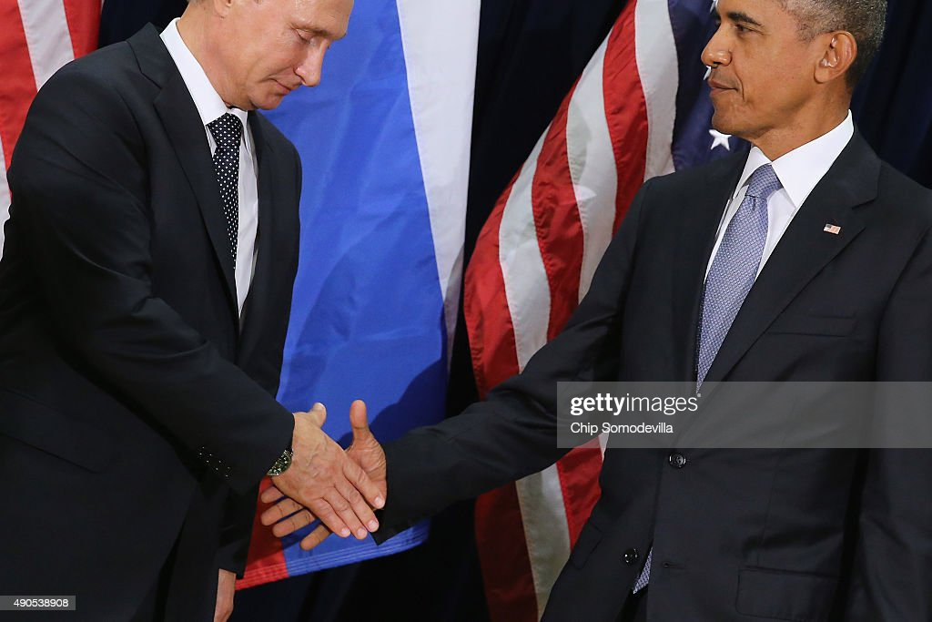 Russian President Valdimir Putin and U.S. President Barack Obama shake hands for the cameras before the start of a bilateral meeting at the United Nations headquarters September 28, 2015 in New York City. Putin and Obama are in New York City to attend the 70th anniversary general assembly meetings.