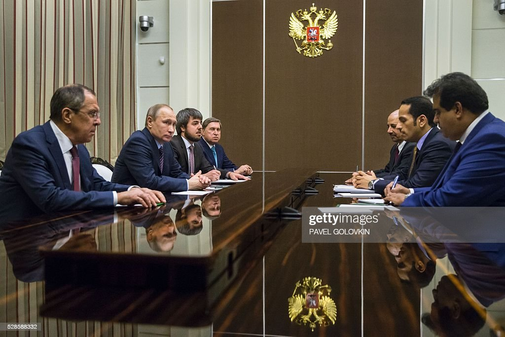 Russian President Vladimir Putin (2nd L), accompanied by Foreign Minister Sergei Lavrov (L), meets with Qatari Foreign Minister Sheikh Mohammed bin Abdulrahman Al-Thani (2nd R) at the Bocharov Ruchei state residence in Sochi on May 6, 2016. / AFP / POOL / Pavel Golovkin