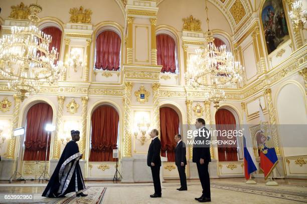 Russian President Vladimir Putin accompanied by Foreign Minister Sergei Lavrov and presidential Aide Yury Ushakov receives diplomatic credentials...