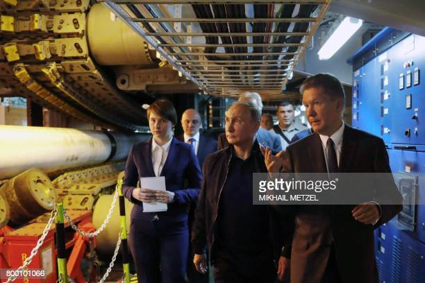 Russian President Vladimir Putin accompanied by Gazprom Chief Executive Officer Alexei Miller visits the Pioneering Spirit pipelaying ship in the...