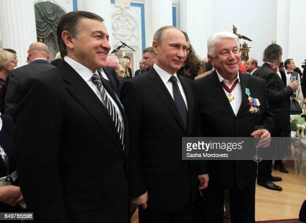 Russian President Vladimir Putin actor Vladimir Vinokur and billionaire Aras Agalarov seen during an awarding ceremony in the Kremlin in Moscow...