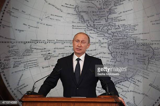 Russian President Vladimir Putin addresses a meeting of the Russian Geographical Society's Board of Trustees on April 27 2015 in St Petersburg Russia...