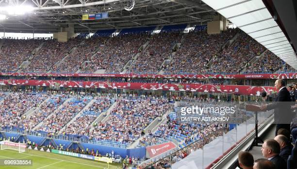 TOPSHOT Russian President Vladimir Putin addresses the crowds during the opening ceremony of the 2017 Confederations Cup group A football match...