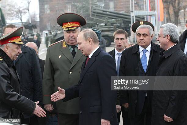 Russian President Vladimir Putin and Armenia's President Serge Sargsyan visit the 102nd military base December 2 2013 in Gyumri Armenia Putin is in a...