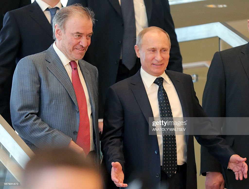 Russian President Vladimir Putin (R) and artistic and general director of the Mariinsky Theatre Valery Gergiev visit the new stage of the Mariinsky II before the Grand gala dedicated to its opening in Saint Petersburg on May 2, 2013. Russia's famous Mariinsky theatre in Saint Petersburg was to inaugurate a new ballet and opera house on May 2 in an event coinciding with the 60th birthday of its hugely ambitious and well-connected director Valery Gergiev. AFP PHOTO / POOL / ANATOLY MALTSEV