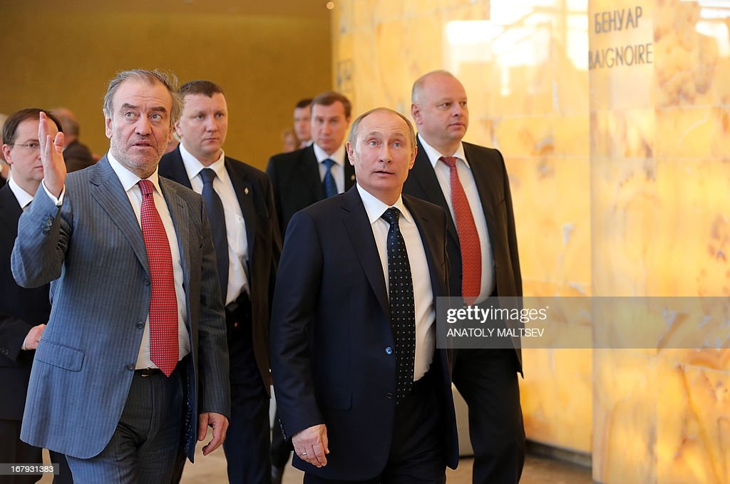 Russian President Vladimir Putin (C) and artistic and general director of the Mariinsky Theatre Valery Gergiev (L) visit the new stage of the Mariinsky II before the Grand gala dedicated to its opening in Saint Petersburg on May 2, 2013. Russia's famous Mariinsky theatre in Saint Petersburg was to inaugurate a new ballet and opera house on May 2 in an event coinciding with the 60th birthday of its hugely ambitious and well-connected director Valery Gergiev.