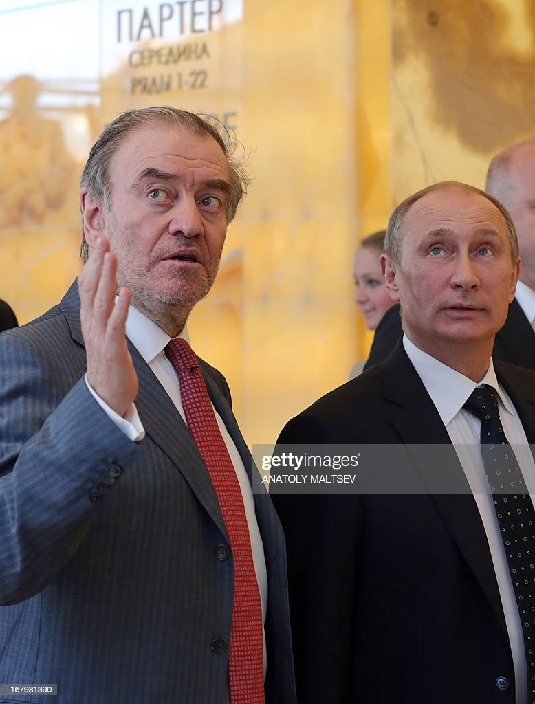 Russian President Vladimir Putin (R) and artistic and general director of the Mariinsky Theatre Valery Gergiev visit the new stage of the Mariinsky II before the Grand gala dedicated to its opening in Saint Petersburg on May 2, 2013. Russia's famous Mariinsky theatre in Saint Petersburg was to inaugurate a new ballet and opera house on May 2 in an event coinciding with the 60th birthday of its hugely ambitious and well-connected director Valery Gergiev.
