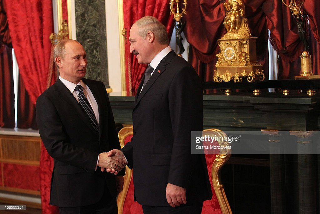 Russian President <a gi-track='captionPersonalityLinkClicked' href=/galleries/search?phrase=Vladimir+Putin&family=editorial&specificpeople=154896 ng-click='$event.stopPropagation()'>Vladimir Putin</a> and Belarus President <a gi-track='captionPersonalityLinkClicked' href=/galleries/search?phrase=Alexander+Lukashenko&family=editorial&specificpeople=542572 ng-click='$event.stopPropagation()'>Alexander Lukashenko</a> shake hands as they attend the Summit of the Collective Security Treaty Organisation (CSTO) on December 19, 2012 in Moscow, Russia. Leaders of Russia, Belarus, Kazakhstan, Kyrgyzstan and Armenia have gathered at the Kremlin in Moscow for the summit.