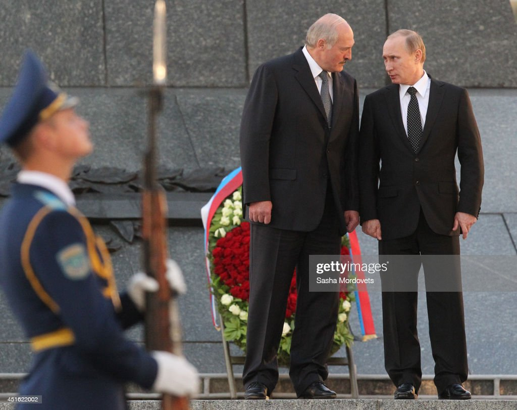 Russian President <a gi-track='captionPersonalityLinkClicked' href=/galleries/search?phrase=Vladimir+Putin&family=editorial&specificpeople=154896 ng-click='$event.stopPropagation()'>Vladimir Putin</a> (R) and Belarusian President <a gi-track='captionPersonalityLinkClicked' href=/galleries/search?phrase=Alexander+Lukashenko&family=editorial&specificpeople=542572 ng-click='$event.stopPropagation()'>Alexander Lukashenko</a> (L) attend a wreath laying ceremony at the Monument of the Victory on July 2, 2014 in Minsk, Belarus. Putin is on a one-day visit to Minsk.