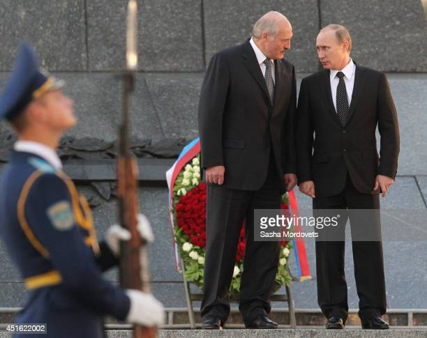 Russian President Vladimir Putin and Belarusian President Alexander Lukashenko attend a wreath laying ceremony at the Monument of the Victory on July...