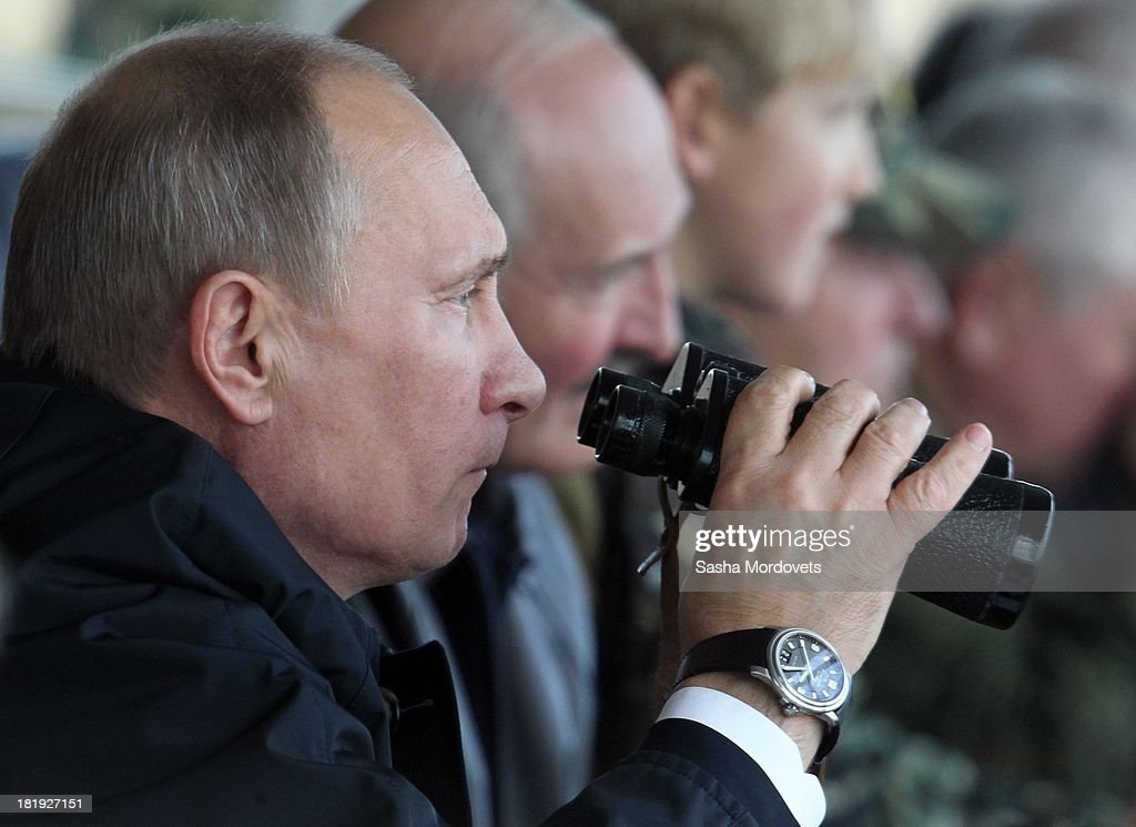Russian President <a gi-track='captionPersonalityLinkClicked' href=/galleries/search?phrase=Vladimir+Putin&family=editorial&specificpeople=154896 ng-click='$event.stopPropagation()'>Vladimir Putin</a> (C) and Belarussian President <a gi-track='captionPersonalityLinkClicked' href=/galleries/search?phrase=Alexander+Lukashenko&family=editorial&specificpeople=542572 ng-click='$event.stopPropagation()'>Alexander Lukashenko</a> (R) watch joint Russian-Belarussian military exercises at the polygon on September 26, 2013 in Grodno, Belarus.
