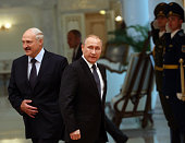 Russian President Vladimir Putin and Belarussian President Alexander Lukashenko arrive to the meeting at the Presidential Palace on June 8 2016 in...
