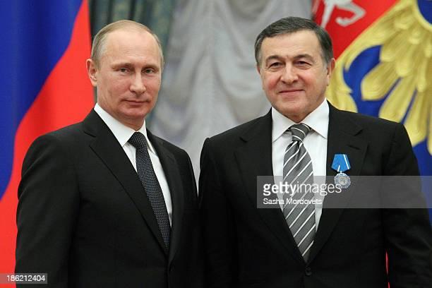 Russian President Vladimir Putin and billionaire Aras Agalarov attend an awards ceremony at the Kremlin October 29 2013 in Moscow Russia Putin...