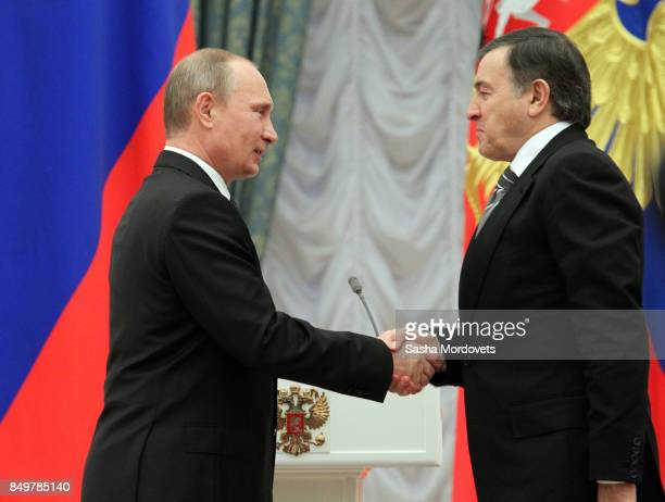 Russian President Vladimir Putin and billionaire Aras Agalarov seen during an awarding ceremony in the Kremlin in Moscow Russia on October 29 2013...