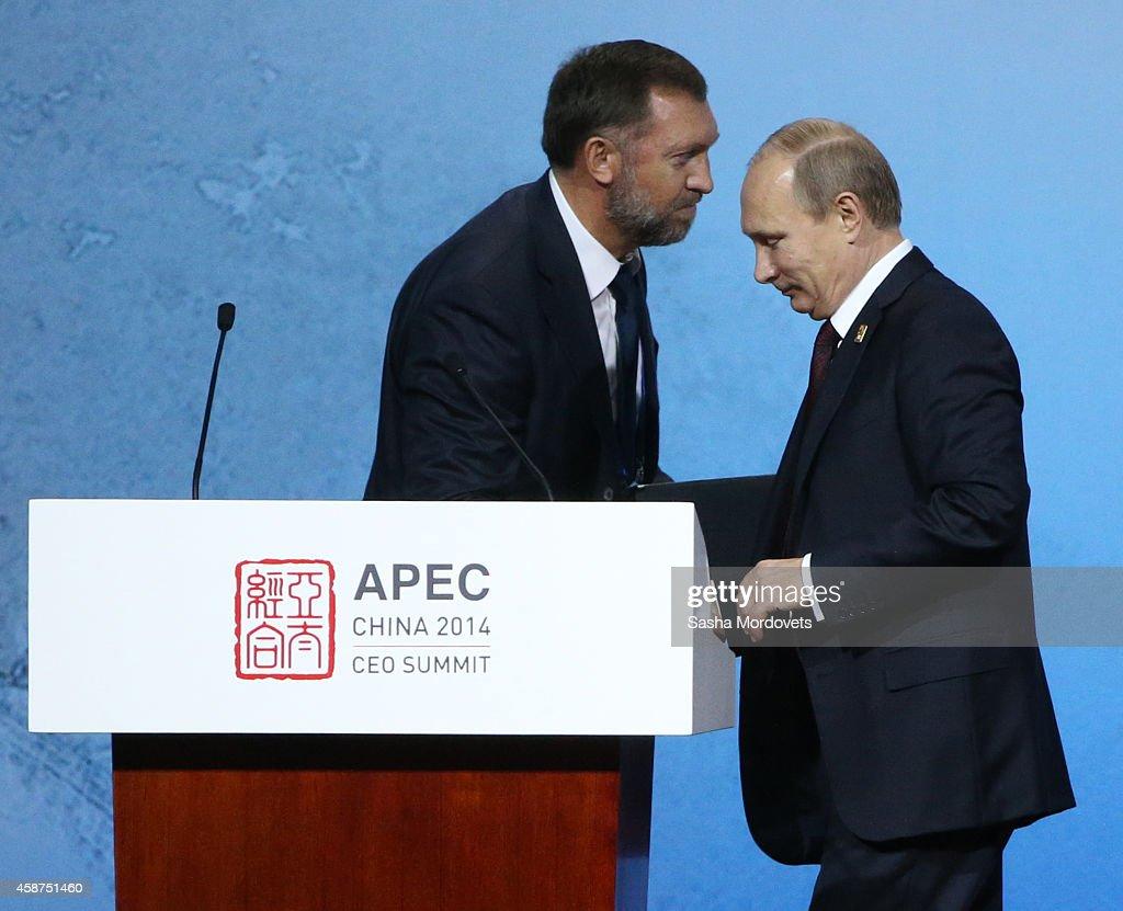 Russian President Vladimir Putin and billionaire Oleg Deripaska attend a APEC Leaders meeting on November 10 2014 in Beijing China The APEC Summit...
