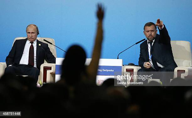 Russian President Vladimir Putin and billionaire Oleg Deripaska speak during a APEC Leaders meeting on November 10 2014 in Beijing China The APEC...